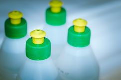Bottles with construction glue/glue in plastic bottles, toned. Bottles with glue. Bottles with construction glue/ glue in plastic bottles, toned stock photo