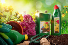 Bottles and containers of gardening products composition nature Stock Photo