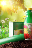 Bottles and containers of gardening products in nature sunlight Royalty Free Stock Images