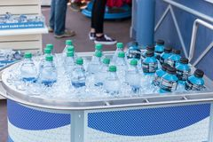 Bottles cooling in ice Stock Photography