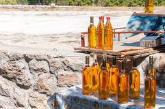 Bottles of croatian homemade wine prosek. On a stall Royalty Free Stock Photos