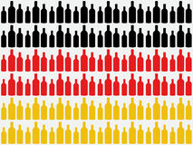 Bottles cut out against German flag Royalty Free Stock Image
