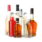 Bottles with different alcoholic drinks. On white background stock photo