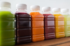 Bottles with different fruit or vegetable juices stock photo
