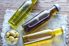 Bottles with different kinds of olive oil Royalty Free Stock Image
