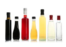 Bottles with different kinds of vinegar. On white background stock photography