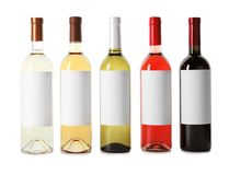 Bottles of delicious wines with blank labels on white background. Bottles of different wines with blank labels on white background royalty free stock photo