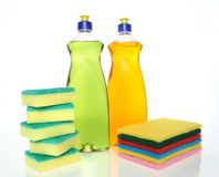 Bottles of dishwashing liquid and sponges Royalty Free Stock Photography