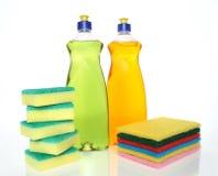Bottles of dishwashing liquid and sponges. Cleaning concept. Dishwashing liquid and sponges royalty free stock photography