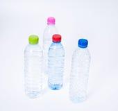 bottles dricksvatten Arkivfoto