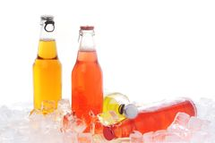 Bottles with  drink in ice Stock Images