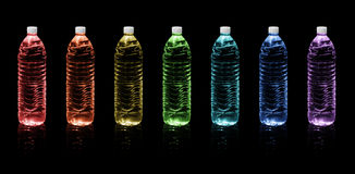 Bottles of drinking water. Rainbow colors Stock Photography