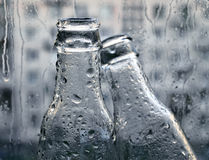 Bottles and drops Royalty Free Stock Images