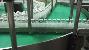 Bottles with drugs on the conveyor line in pharmaceutical factory