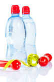 Bottles and dumbbells with tape Royalty Free Stock Images