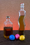 Bottles and Easter eggs Stock Image