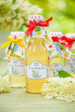 Bottles with elderflower syrup Stock Photos