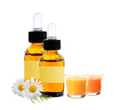 Bottles with essence oil, chamomiles and candles isolated Royalty Free Stock Image
