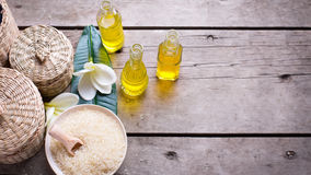 Bottles with essential aroma oil, sea salt and tropical flowers Stock Images