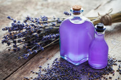 Bottles of essential oil and lavender flowers bunch. Stock Photography