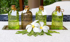 Bottles of essential oils placed on the bed decoration leelawade Stock Photos