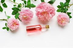 Bottles of essential rose oil for aromatherapy. stock photo