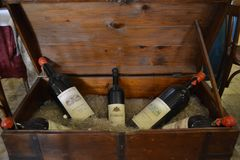Bottles of expensive and old wine in the chest. Several bottles of expensive and old wine in the chest Royalty Free Stock Image