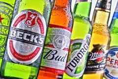 Bottles of famous global beer brands. POZNAN, POL - JULY 19, 2018: Bottles of famous global beer brands including Heineken, Bud, Miller, Tuborg, Becks, Stella royalty free stock photo
