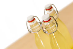 Bottles filled with elderflower syrup, shallow DOF Stock Photography