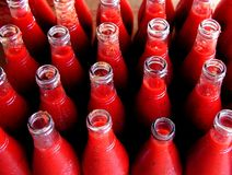Bottles filled with tomato puree Royalty Free Stock Photos
