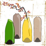 Bottles and flowers. Royalty Free Stock Photography