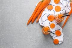 Bottles of fresh carrot juice. On grey background Stock Photo