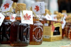Bottles of fresh maple syrup for sale at Ben`s Sugar Shack in Temple, N.H., USA, March 24, 2018. Maple syrup is made from pure maple sap. The traditional method Royalty Free Stock Photo