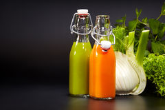 Bottles with fresh vegetable juices Stock Photo