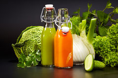 Bottles with fresh vegetable juices. Isolated on black. Detox diet stock photos