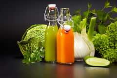 Bottles with fresh vegetable juices. Isolated on black. Detox diet stock photo