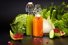 Bottles with fresh vegetable juices. Isolated on black. Detox diet stock images