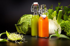 Bottles with fresh vegetable juices. Isolated on black. Detox diet stock image