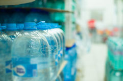 Bottles with fresh water in supermarket Royalty Free Stock Images