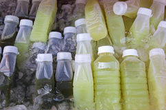 Bottles of Fruit Juices Stock Images