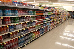 Bottles Gatorade. Isle with Bottles of Gatorade sports energy isotonic drink in Supermarket Stock Image