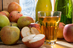 Bottles and glass of cider with apples Royalty Free Stock Photo