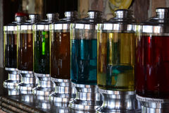 Bottles. Glass bottles with  colored rum Stock Images