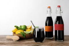 Bottles and glass with natural charcoal lemonade royalty free stock images