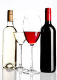 Bottles and glass of red and white wine reflection Royalty Free Stock Photography