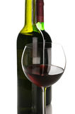 Bottles and glass of red wine Stock Image