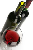 Bottles and glass of red wine Royalty Free Stock Images