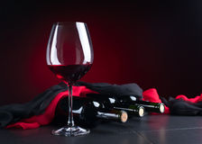 Bottles and glass of red wine Royalty Free Stock Photos