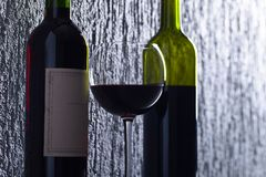 Bottles and glass of red wine . Royalty Free Stock Photo