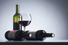 Bottles and glass of red wine . Stock Photo